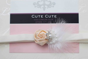 Ivory satin rose with marabou feather and rhinestone flower