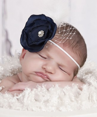 Layered navy satin flower with rhinestone, feather and net on a soft elastic headband