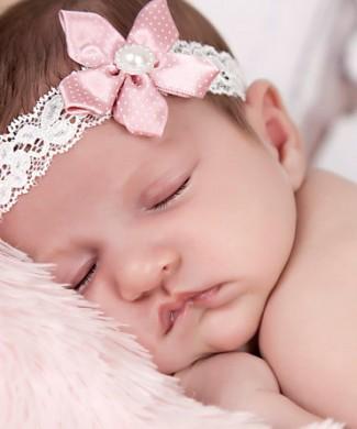 Delicate dusky pink satin flower on an ivory lace headband