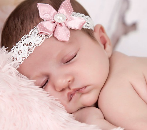 Delicate dusky pink satin flower on an ivory lace headband