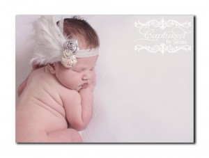 White feather pad, with satin roses, rhinestone and Swarovski crystals on a soft elastic headband