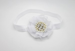 White chiffon flower with pearls and stones on soft elastic headband