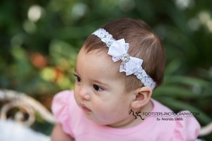 White satin bow with lace and rhinestone