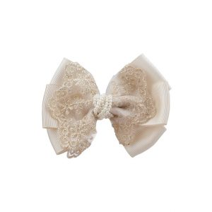 Oversized bow with gold lace and pearls in ivory