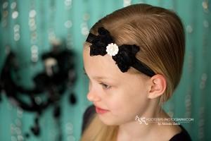 Black rosey bow with large rhinestone