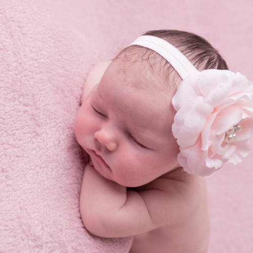 Pink rose with rhinestone on a soft elastic headband