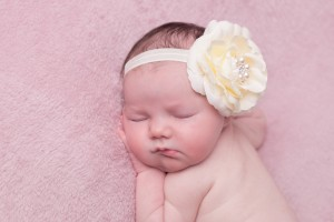 Ivory rose with rhinestone on a soft elastic headband