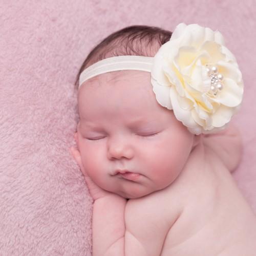 Ivory rose with rhinestone on a soft elastic headband