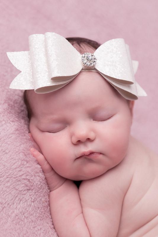 White oversized glitter bow with rhinestone headband