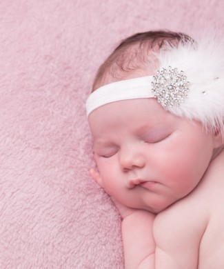 White feather headband with large rhinestone and Swarovski diamante