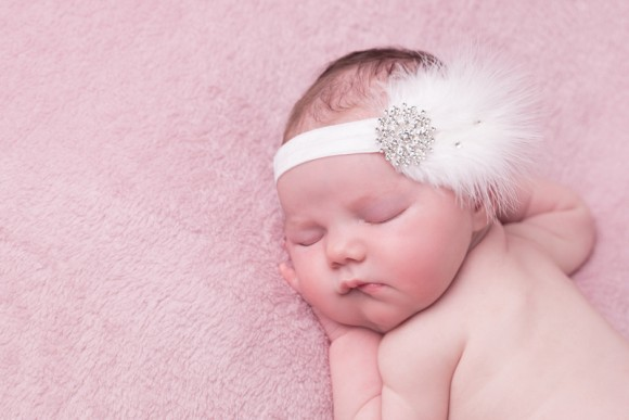 White feather headband with large rhinestone and Swarovski diamante